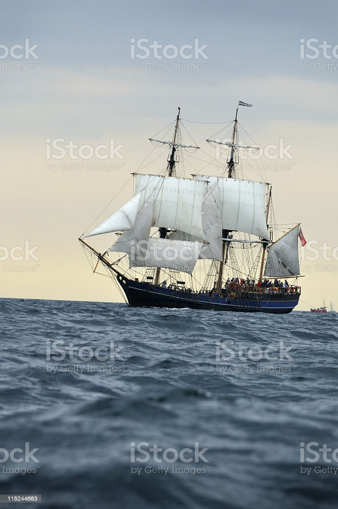 A ship sailing through the ocean stock photo
