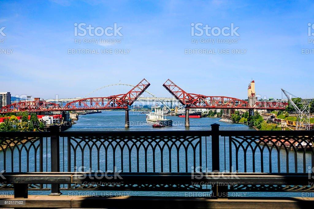 Ship sailing under the bridges of Portland OR stock photo