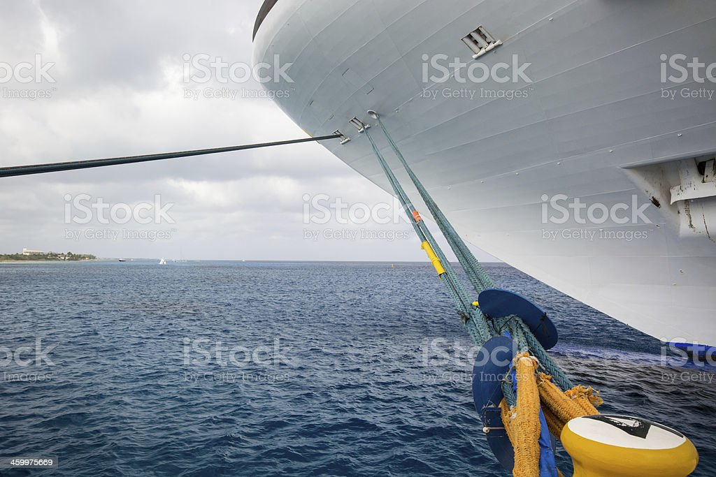 Ship tied to dock with rat guards in place stock photo