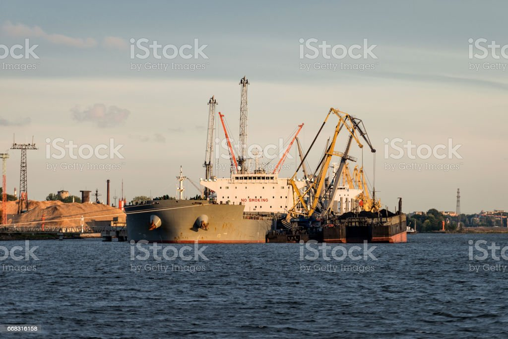 Ship transshipment of the port channel. stock photo