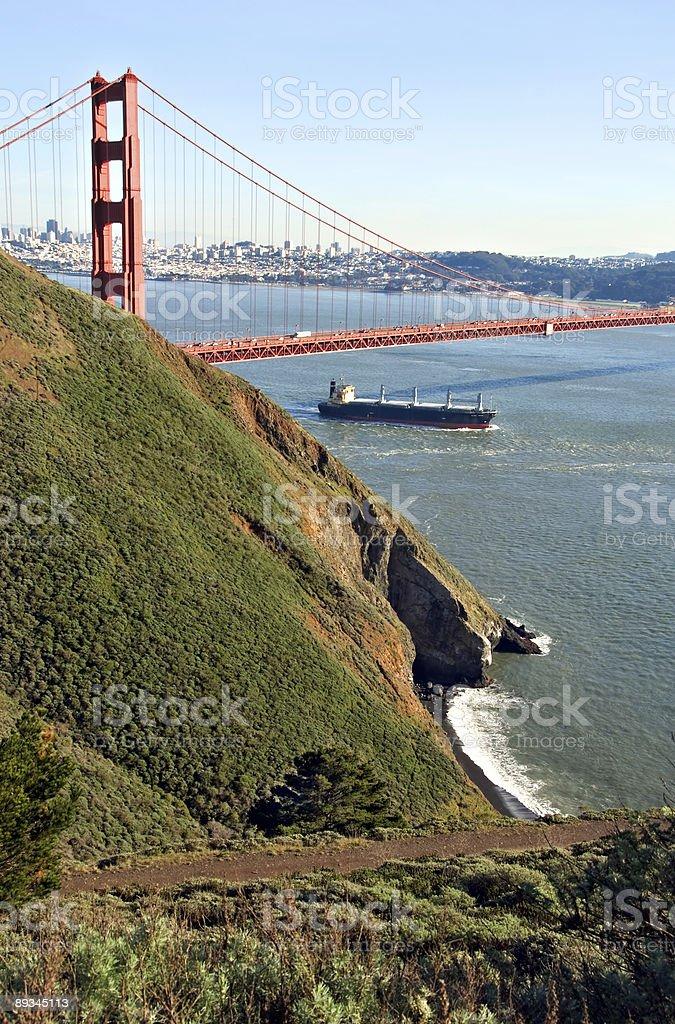 Ship under Golden Gate Bridge royalty-free stock photo