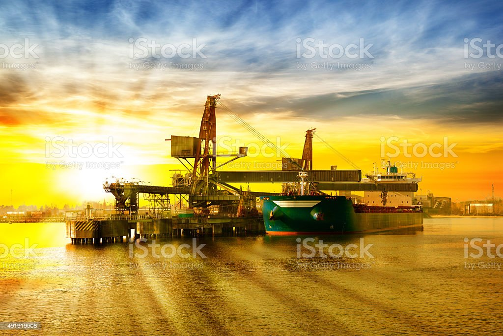 Ship under loading stock photo