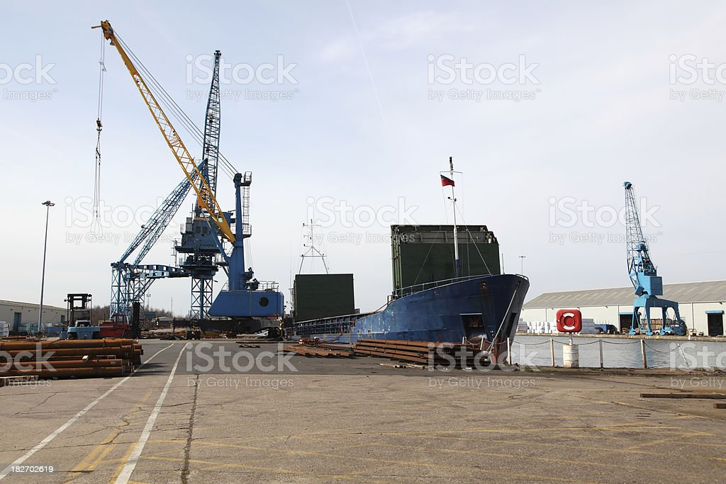ship unloading in dock stock photo