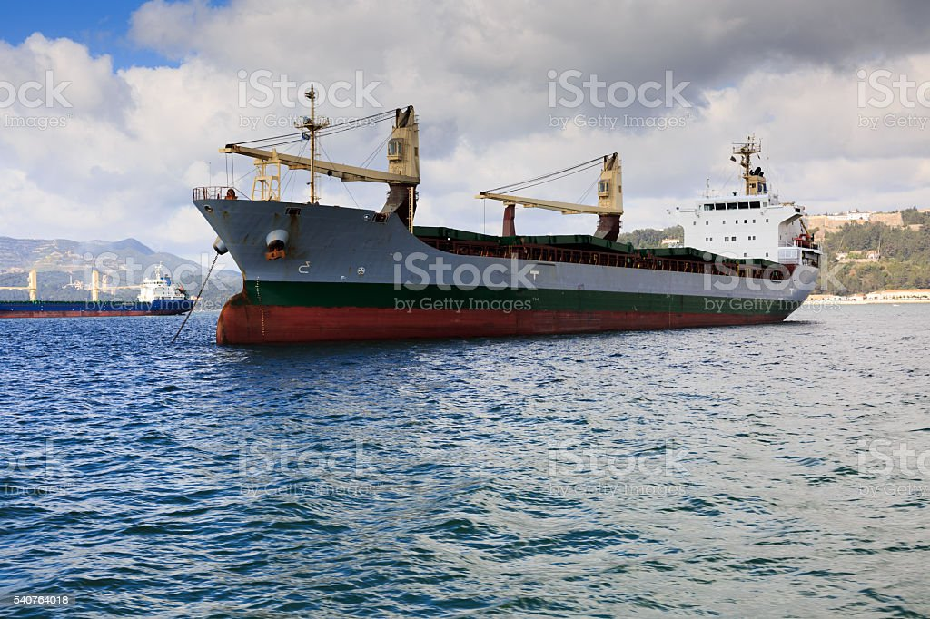 ship waiting outside the city of Setubal in Portugal stock photo