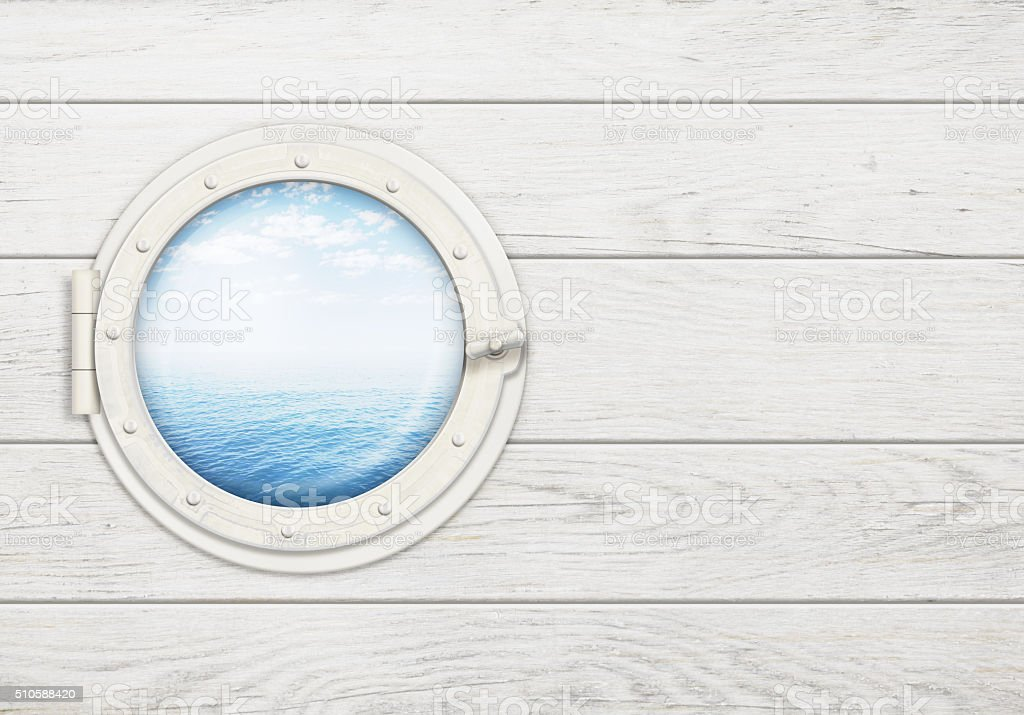 ship window or porthole on wooden wall with ocean horizon stock photo