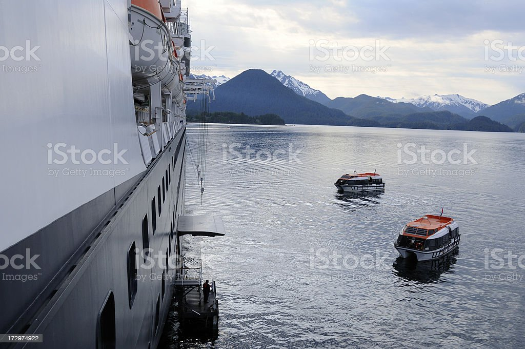 Ship with life boats in the water. stock photo