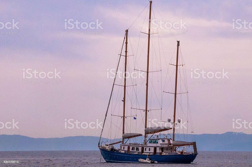 Ship with sails at calm sea stock photo