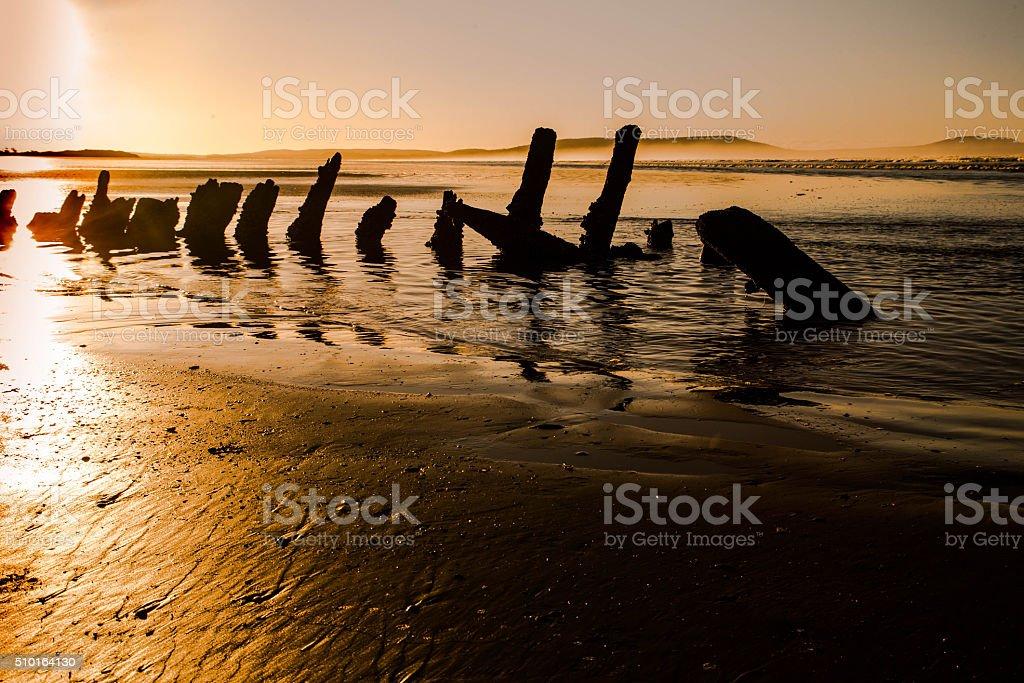 ship wreck on beach stock photo