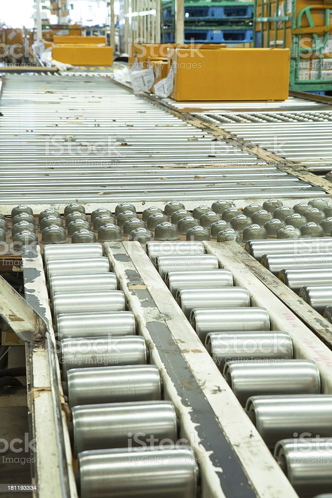 Shipping box on a conveyor belt royalty-free stock photo