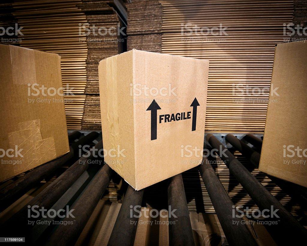Shipping box on conveyer belt. royalty-free stock photo