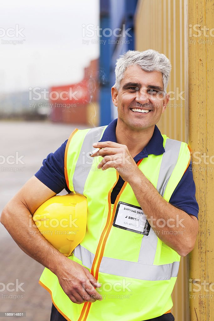 shipping company worker smoking stock photo