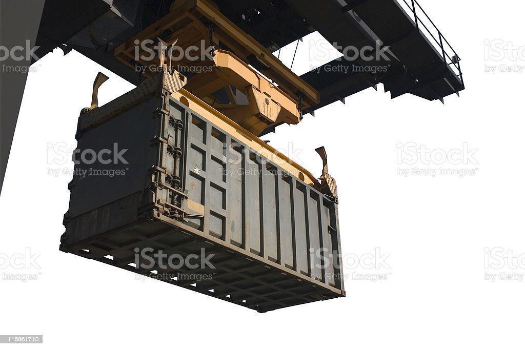 Shipping container being unloaded by a crane royalty-free stock photo