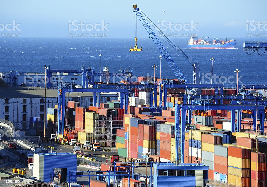Shipping containers in harbor ready for loading royalty-free stock photo