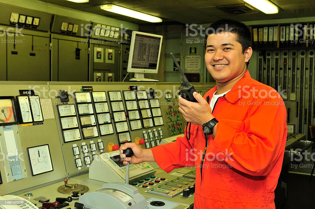 Shipping engineer with orange suit stock photo
