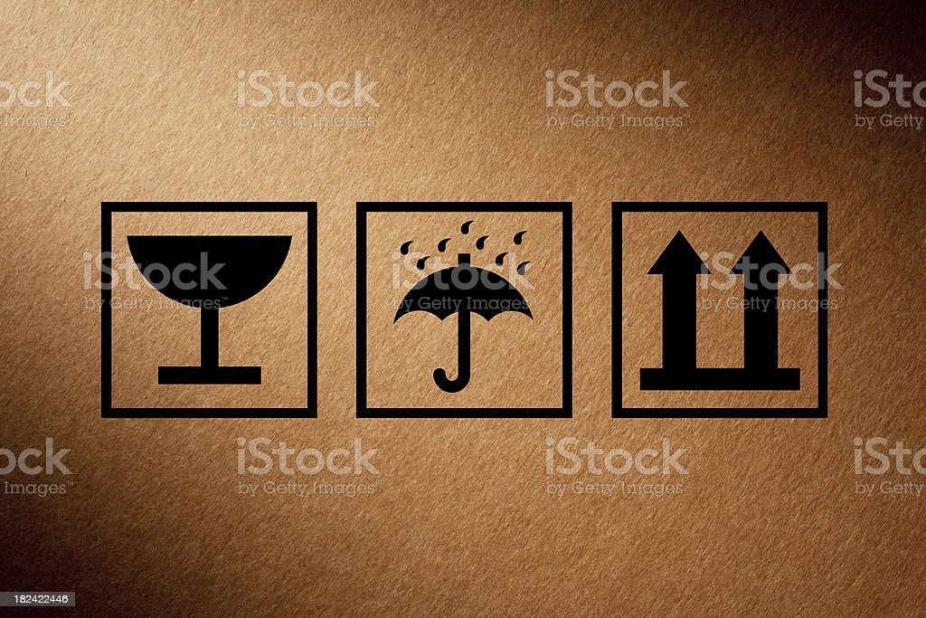 Shipping icons on cardboard box stock photo