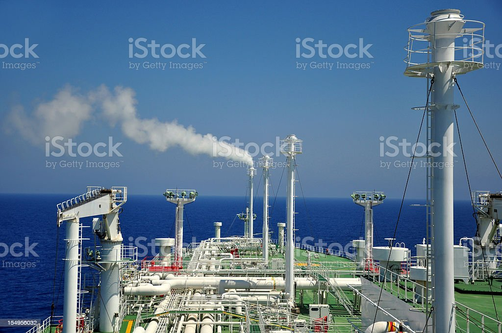 Shipping industry - LNG Tanker (venting methane gas) stock photo