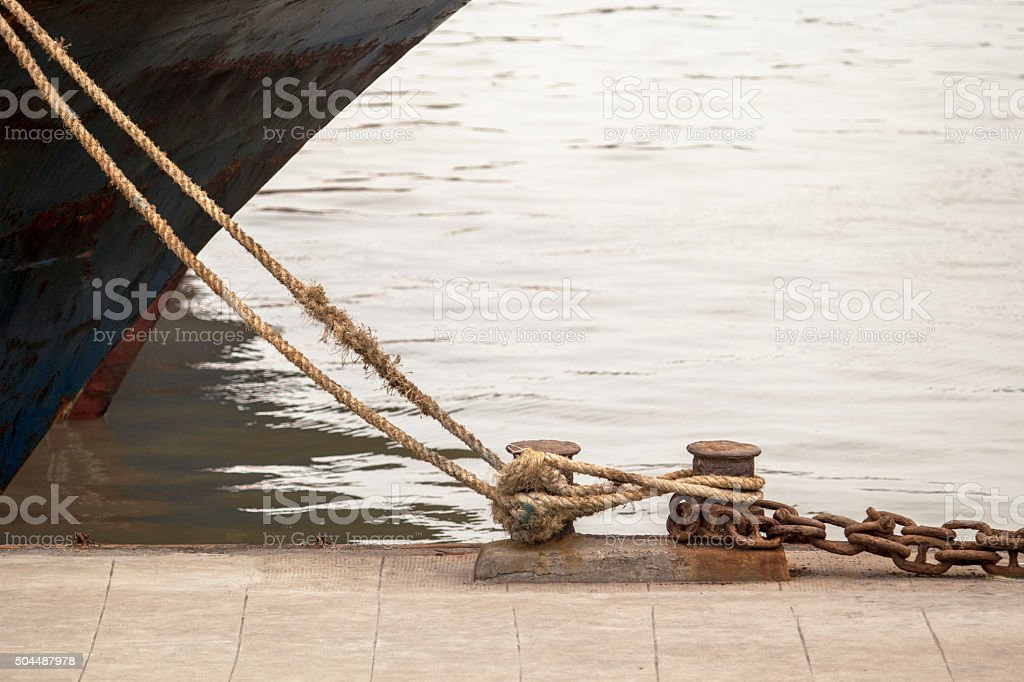 ship,rope and bollards at waterside stock photo