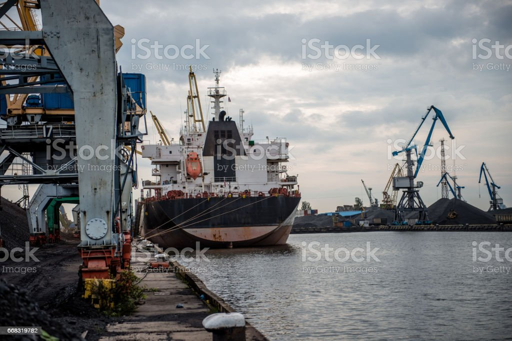 Ships and cranes at a port terminal. stock photo