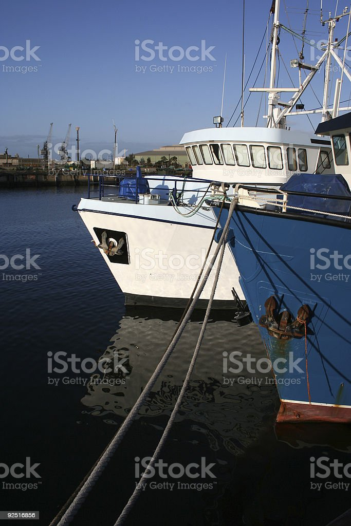 Ships at dock stock photo
