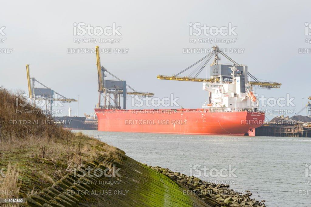 Ships at IJmuiden steel mill of Tata Steel Unlimited stock photo