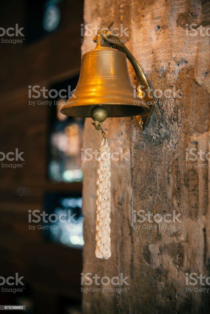 ship's bell in bar stock photo