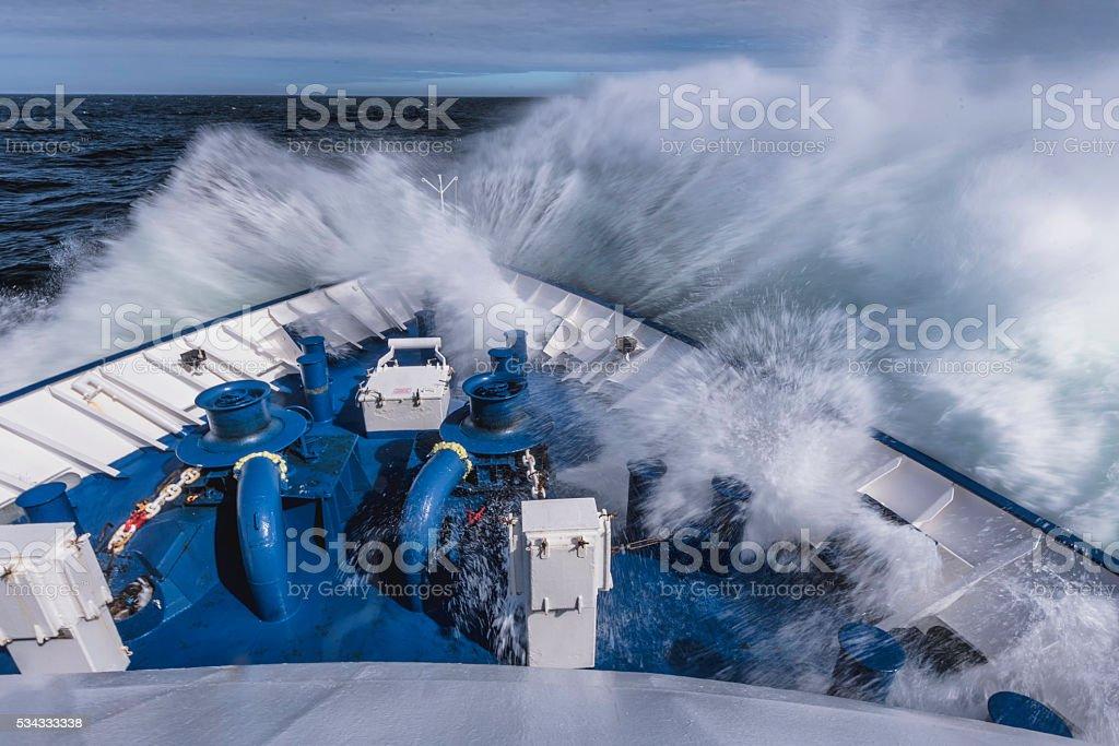 Ship's Bow hitting big wave stock photo