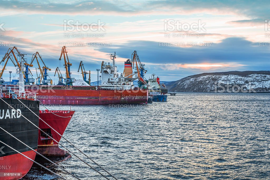 Ships by berths in the port of Murmansk  . stock photo