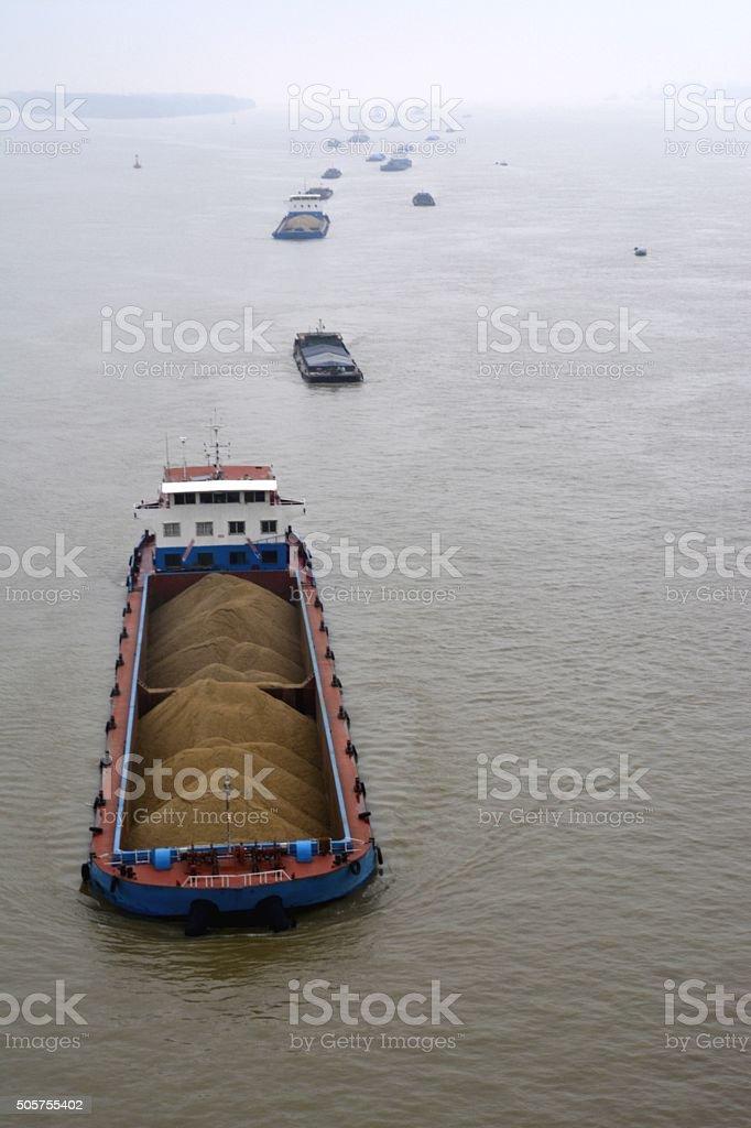 Ships carrying coal on Yangtze River, Nanjing, China stock photo