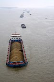 Ships carrying coal on Yangtze River, Nanjing, China
