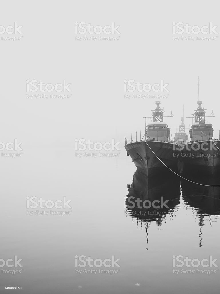 Ships docked in still harbor stock photo