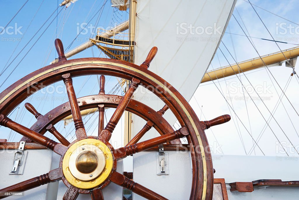 Ships helm on deck of a clipper ship stock photo