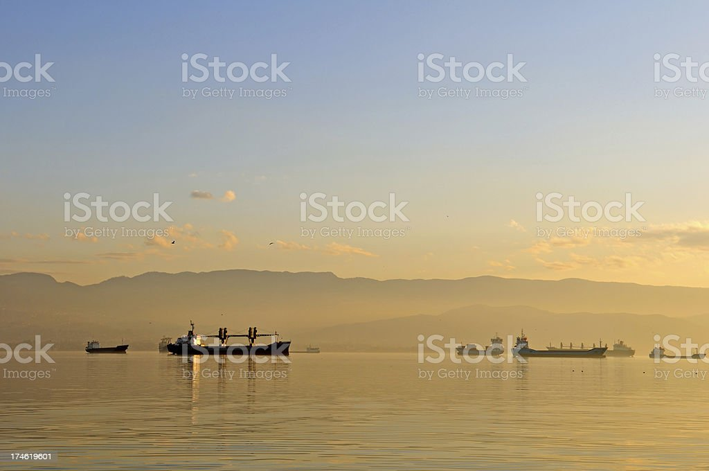 ships in the fog on sunset royalty-free stock photo