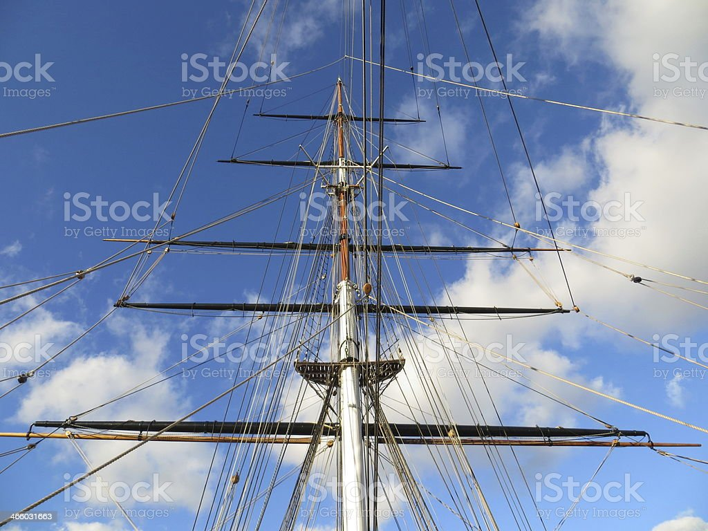 Ship's mast reaching the clouds stock photo