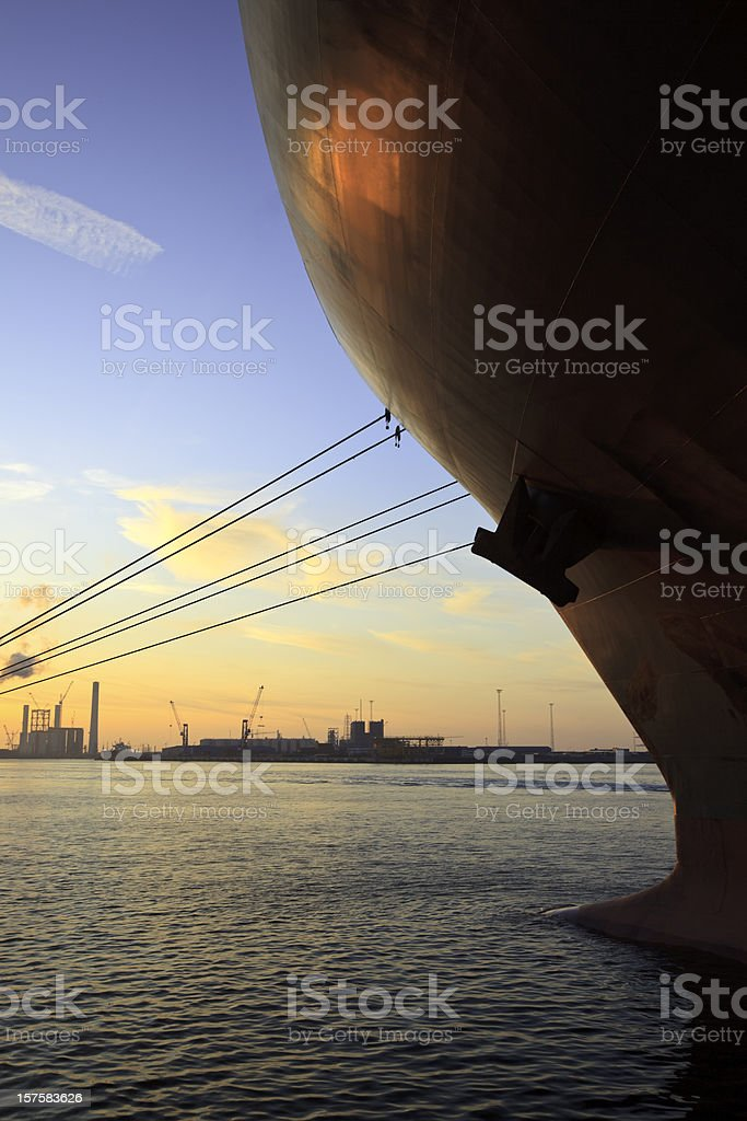 A ships now on the water at sunset stock photo