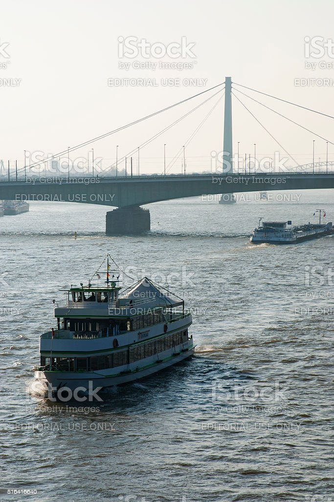Ships on Rhine river in Cologne and bridges stock photo