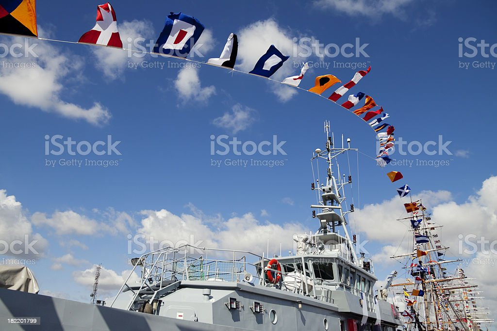 Ships' rigging and colourful flags royalty-free stock photo