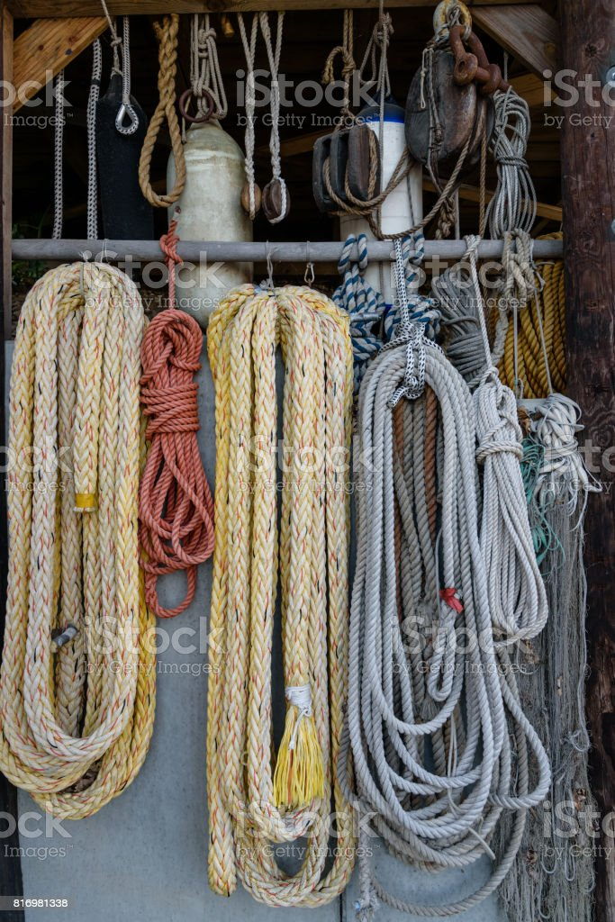 Ships rigging, ropes, fishing nets, rope ladders. Vertical stock photo