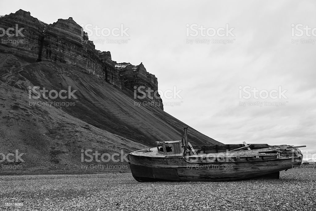 Shipwreck and cliffs in Skansbukta, Billefjorden, Spitsbergen, Svalbard Islands, Norway royalty-free stock photo