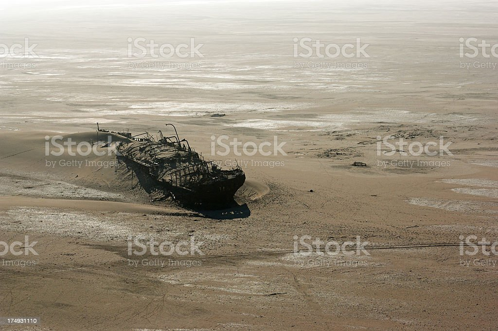 Shipwreck in the deep sand stock photo