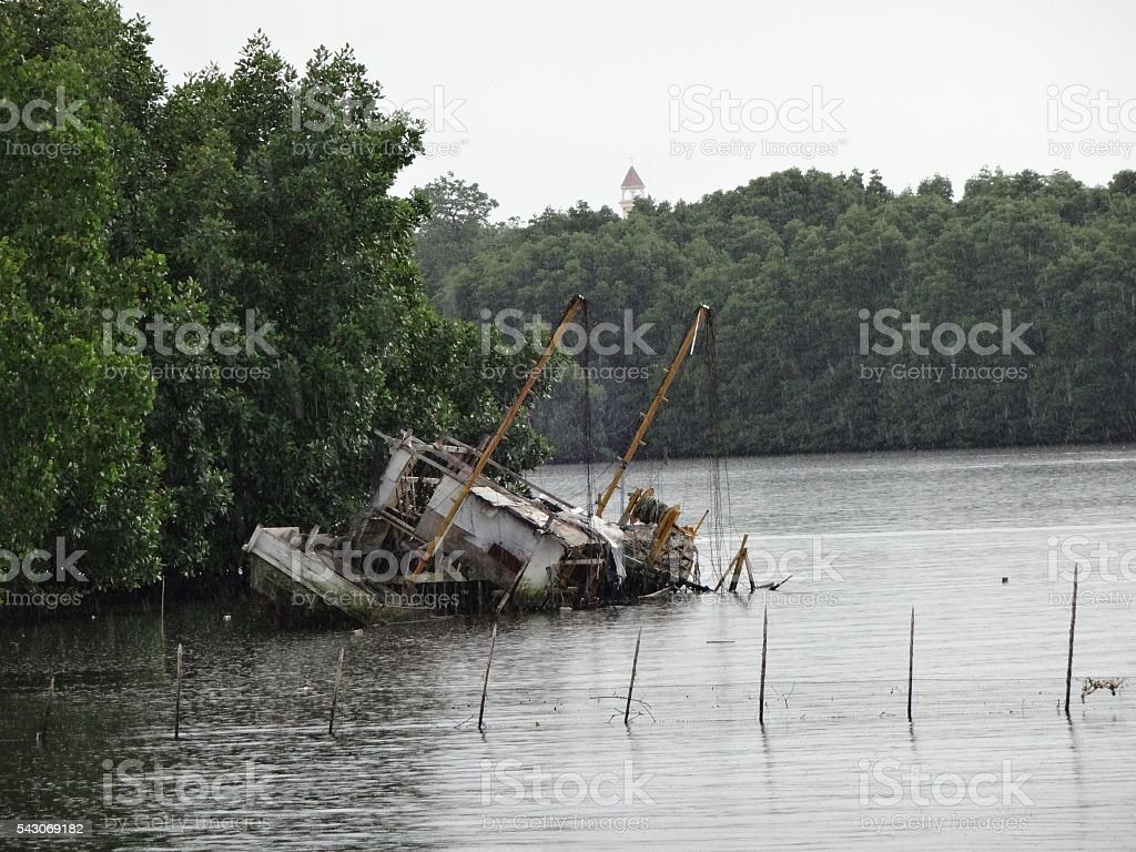Shipwreck in the rain and high tide stock photo