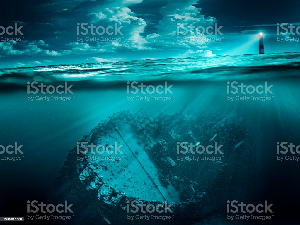 Shipwreck is illuminated by the lighthouse stock photo