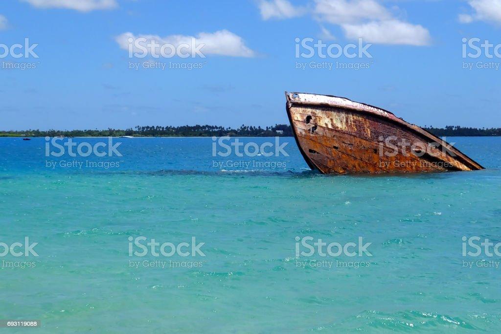 Shipwreck off the coast of Pangaimotu island in Tonga stock photo