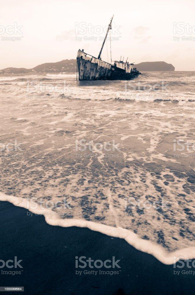 shipwreck on beach in monochrome stock photo