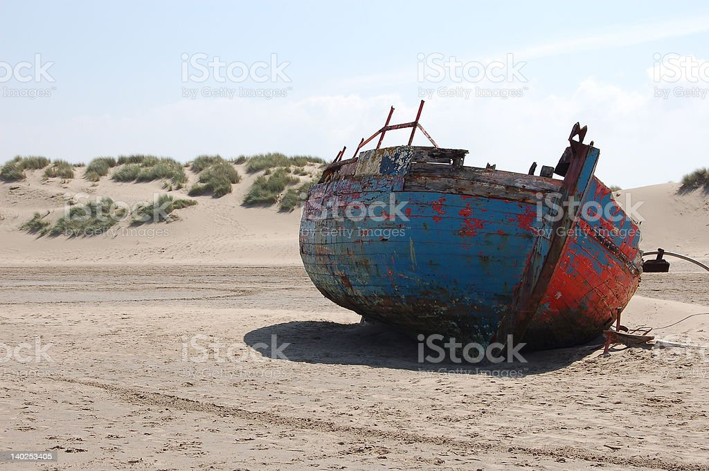 shipwreck on beach royalty-free stock photo