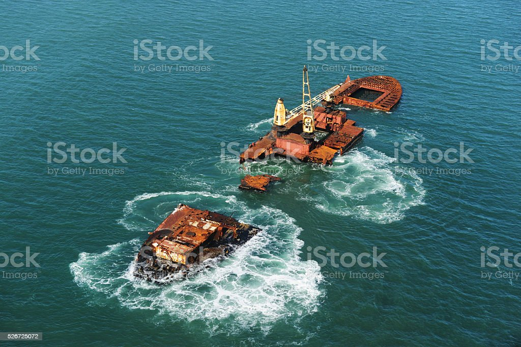 Shipwreck - ship broken in two with vast sea stock photo