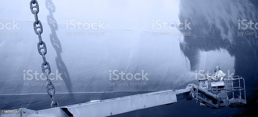 Shipyard worker paint the ship stock photo
