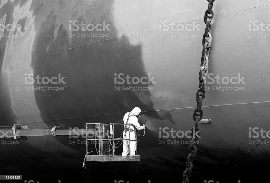 Shipyard worker paint the ship royalty-free stock photo