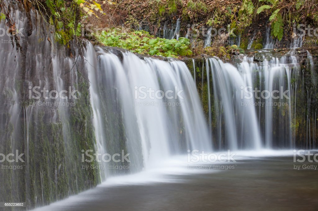 Shiraito Waterfall in autumn season stock photo