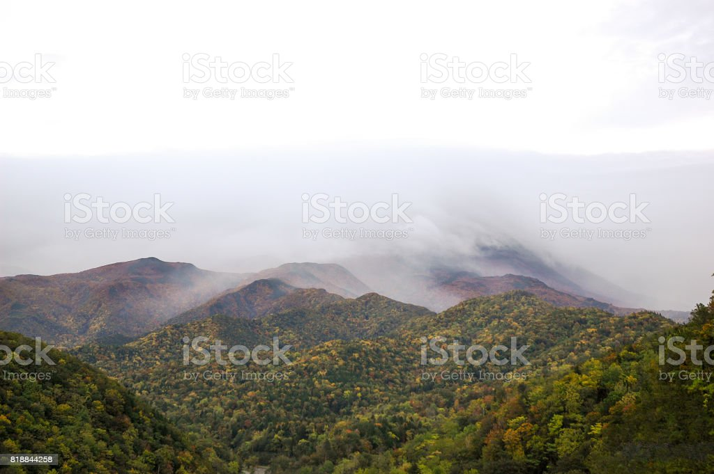 Shiretoko Mountains Covered in Clouds in Autumn, Eastern Hokkaido, Japan stock photo