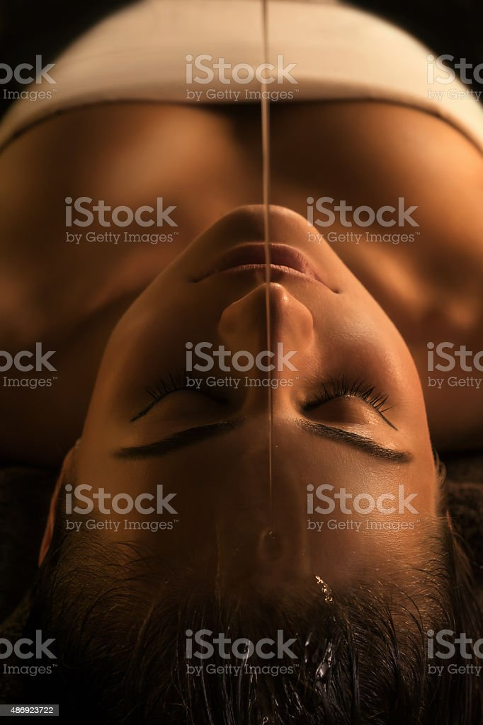 Shirodhara massage - close-up stock photo